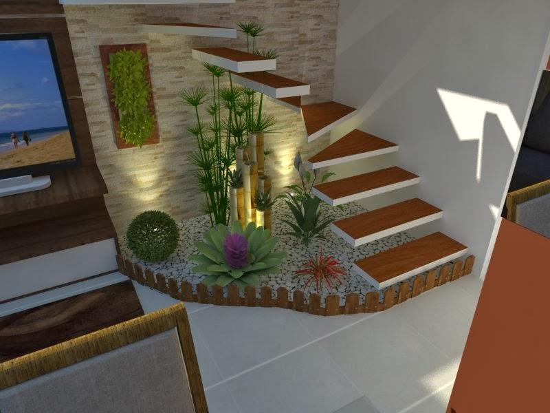 Outra amostra de um pequeno jardim de inverno sob a escada. Veja que nesse caso, tratam-se apenas de algumas plantas, mas que já dão um toque de vida ao ambiente.