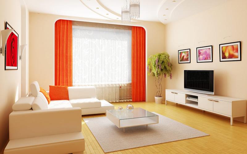 Sala decorada com cores claras e vibrantes.