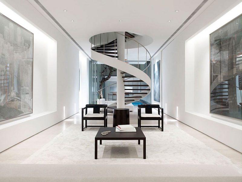 Esta escada em espiral moderna e minimalista está localizada em uma casa de Cingapura, desenhada por Ong & Ong Arquitetos