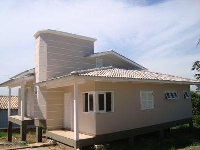 Modelo de casa de classe média em alvenaria, suspenso por pilares