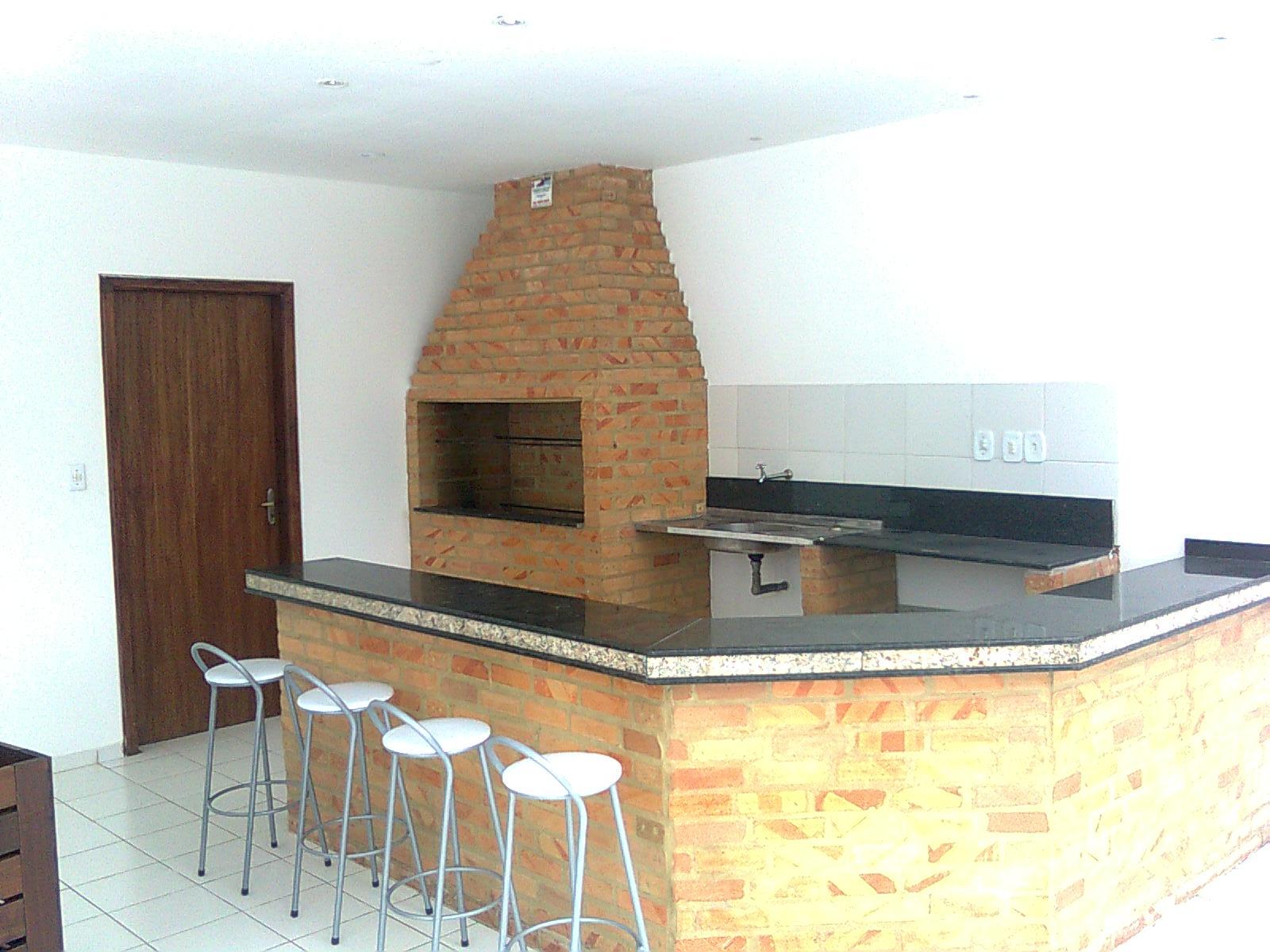 Foto de um espaço gourmet com churrasqueira e bancadas feitas com alvenaria de tijolo maciço