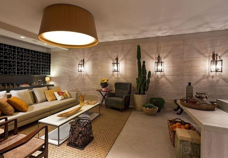 parede da sala decorada com luminárias de parede com carater bem decorativo