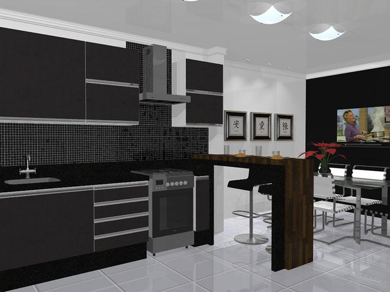 Nessa cozinha preta, a bancada de madeira dá um toque de charme a decoração