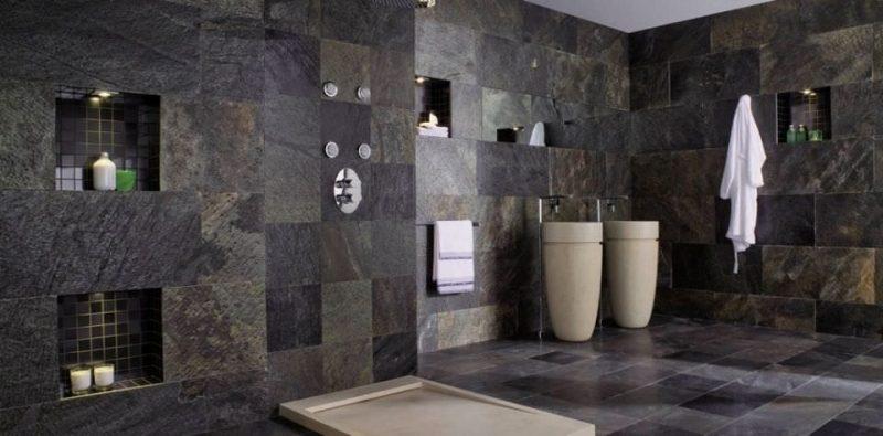 Os tons escuros da ardósia dão um ar super sofisticado ao revestimento dessa parede