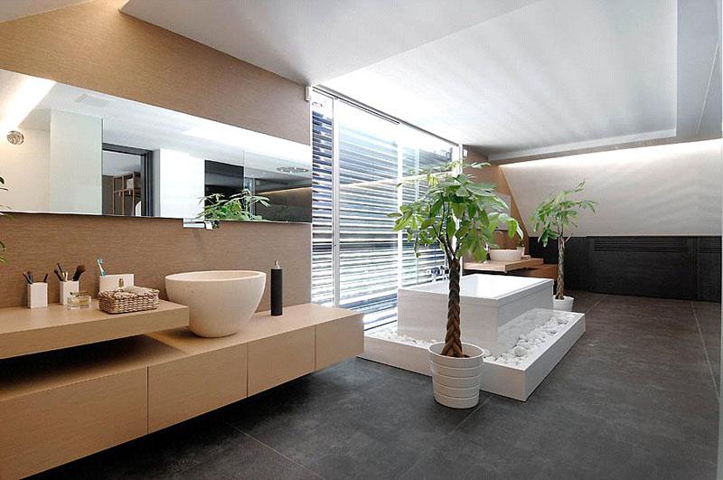 Já esse espaço usa móveis pendentes e angulados para dar um toque moderno para banheiro clean