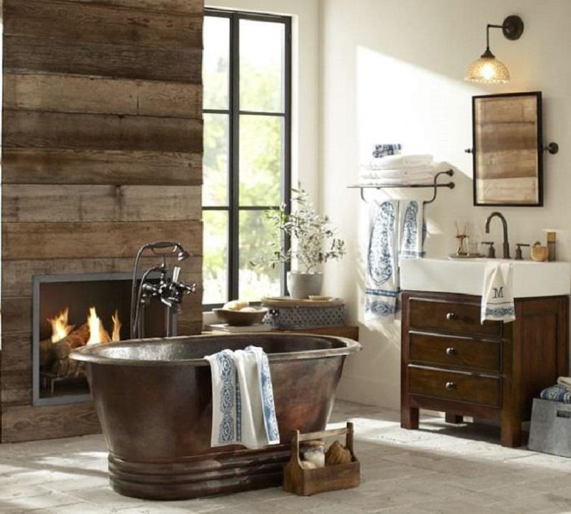 Madeira e cobre são materiais fundamentais para compor uma decoração rústica ao banheiro.