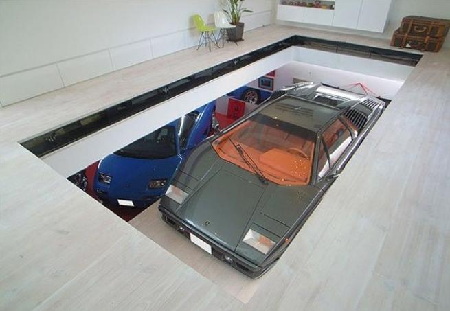 Elevador de veículos em garagem residencial