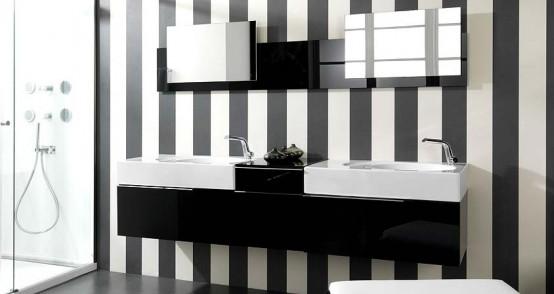 Já esse banheiro segue uma linha mais sofisticada usando listras preto e branco em suas paredes