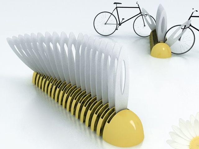 Hastes móveis formam esse bicicletário que lembra um grande canivete