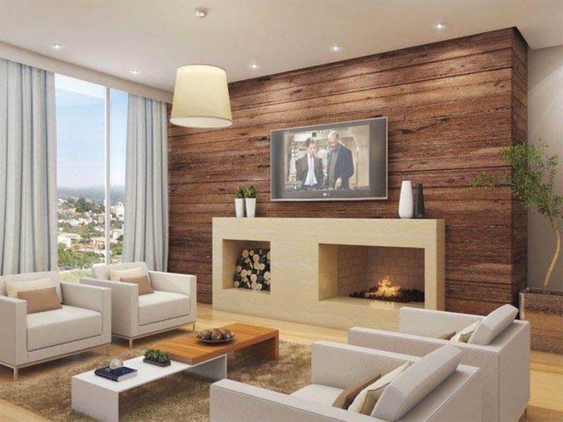 Decoração de Home Cinema com lareira e parede de madeira