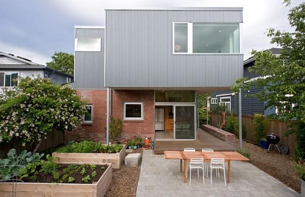 residência contemporânea com térreo em alvenaria aparente