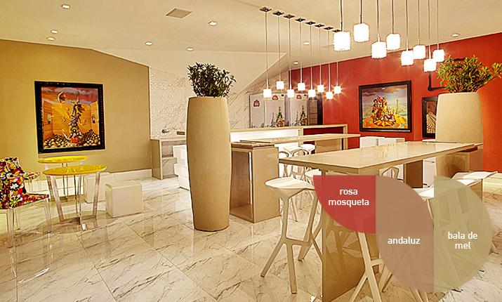 Já essa cozinha integrada usa detalhes de pintura como paredes vermelhas e bege em tinta óleo