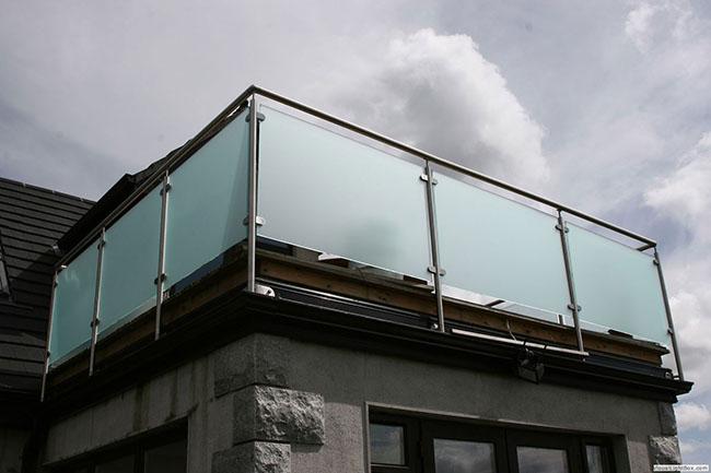 laje com guarda corpo de vidro