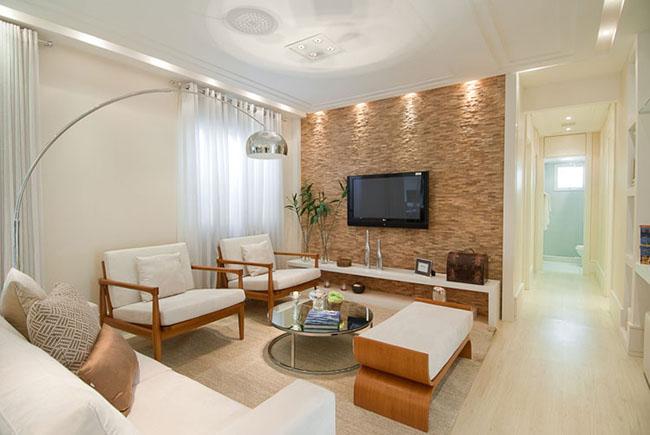 A iluminação é i, fator especial nesse ambiente: você pode usar spots de luz para dar destaque a elementos da decoração e móveis da sala de estar