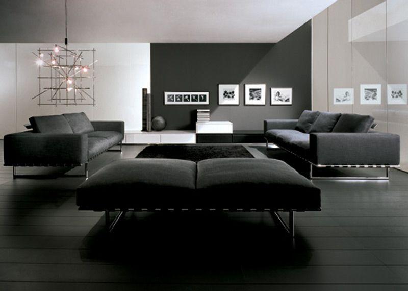 Decoração de sala de estar preta com piso e móveis nem cor escura, parede e forro em cores claras