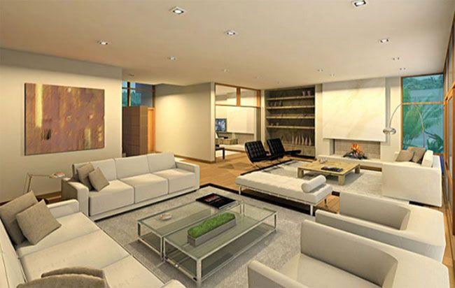 Essa sala é mobiliada com sofás e mesas de linhas retas e sóbrias