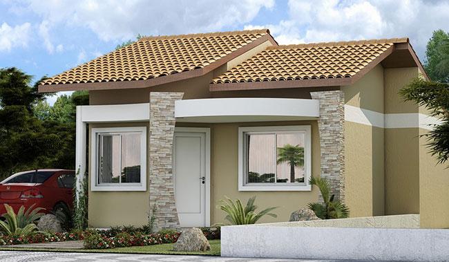 Fachada de casa popular com pilares de pedra