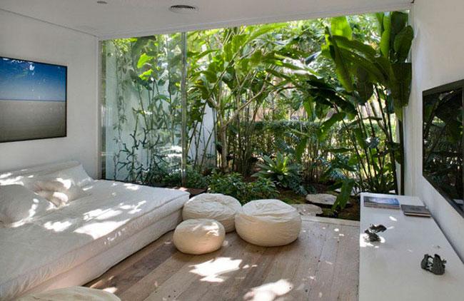 Jardim de inverno em quarto de casal moderno