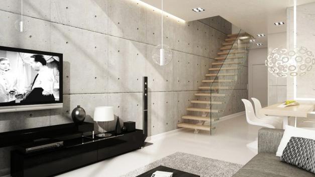Parede de concreto armado usada na decoração de sala de TV