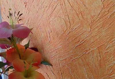 Textura rústica em parede aplicada com desempenadeira