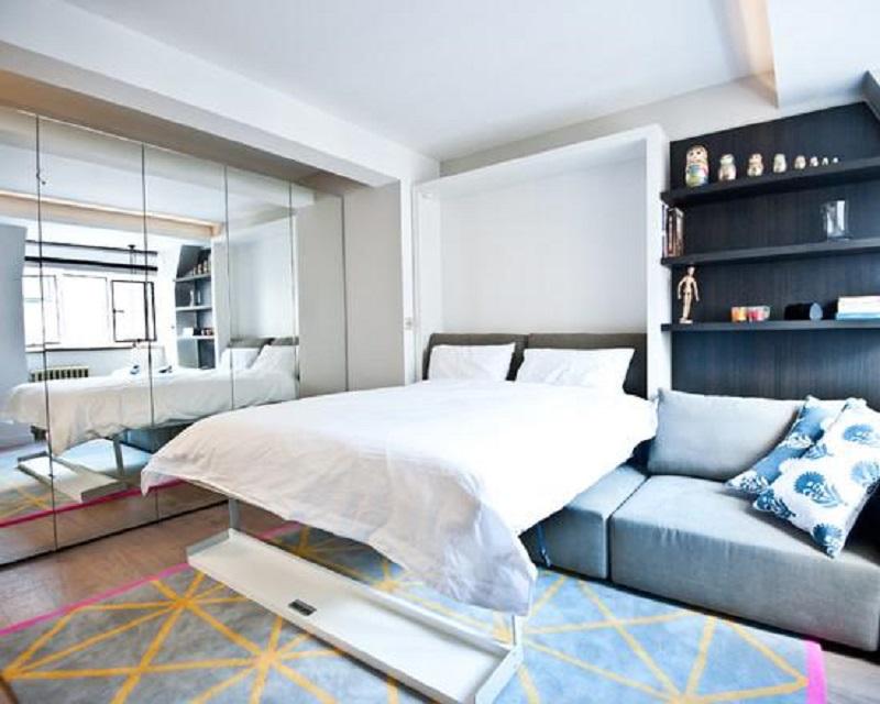 Cama retrátil - utilizada apenas na hora de dormir, dando espaço ao ambiente no resto do tempo
